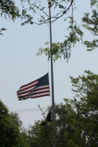 File photo. Flag at half-staff at Veterans Park.