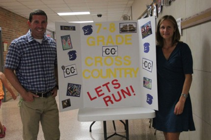 xx and xx talk to potential cross-country runners at a table set up at last week's open house.