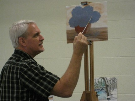 Photo by Susan Gartner. Steve Wood shows students how to paint.