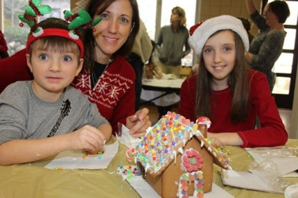 About 100 families decorated a gingerbread house for free during Chelsea's Hometown Holiday on Saturday.
