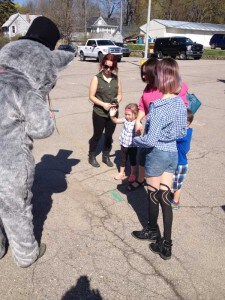 Folks of all size met Reggie the Recycling Racoon Saturday at the opening of the Chelsea Farmers Market.